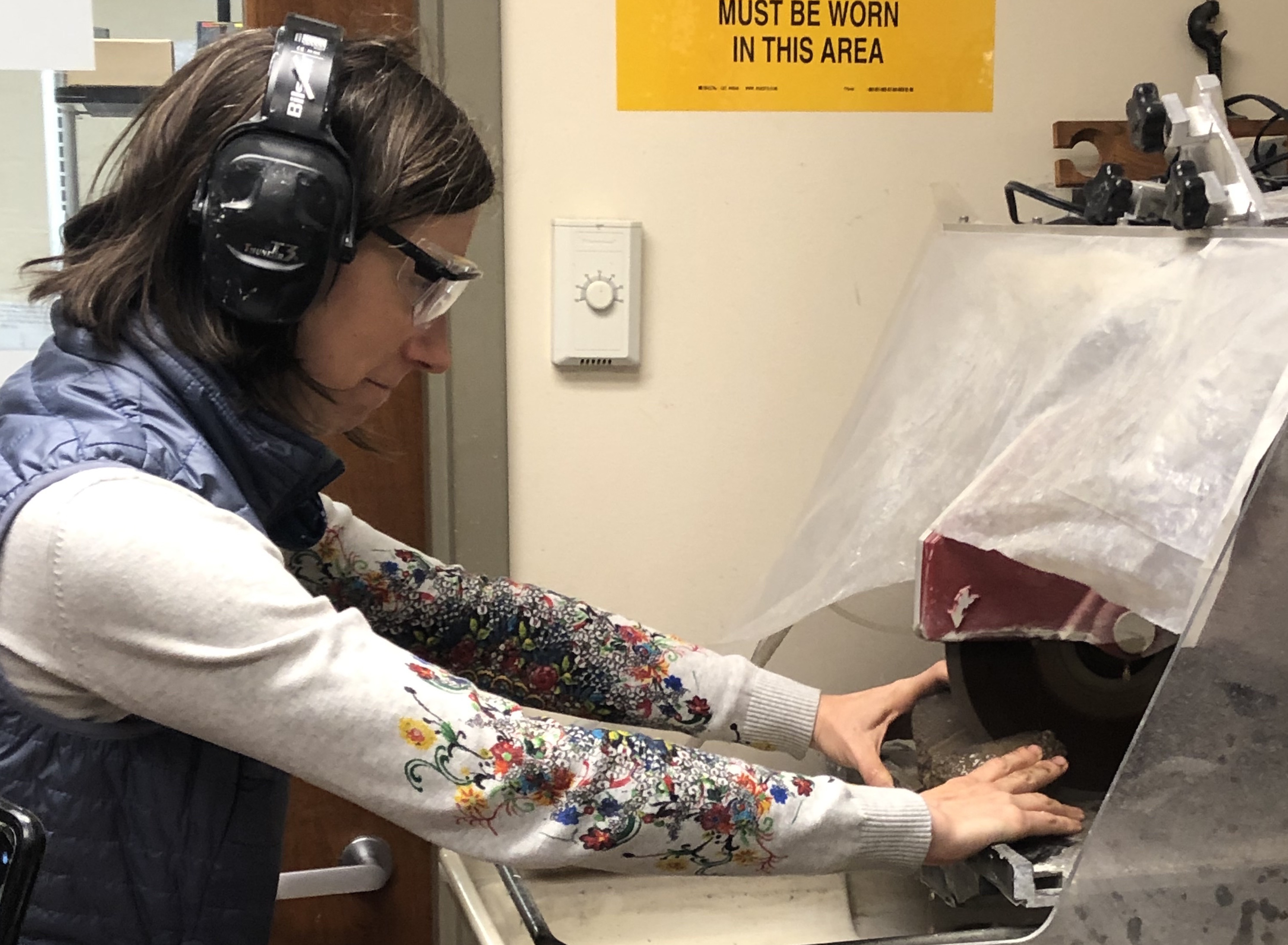Image of Dr. Juliane Gross cutting her chondrite sample for the new exhibit
